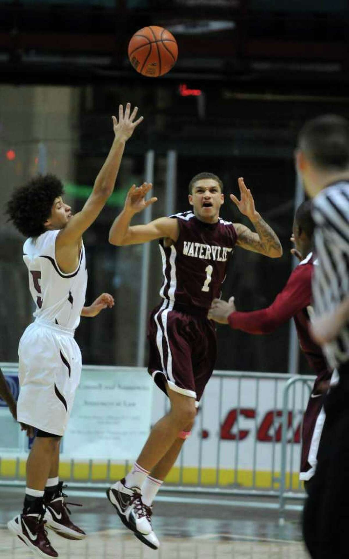 Watervliet's Jordan Gleason, right, and Lansingburgh's Dante Carr, left, battle for the ball during Watervliet's 50-46 victory at the Times Union Center on Sunday Jan. 29, 2012 in Albany, NY. (Philip Kamrass / Times Union )