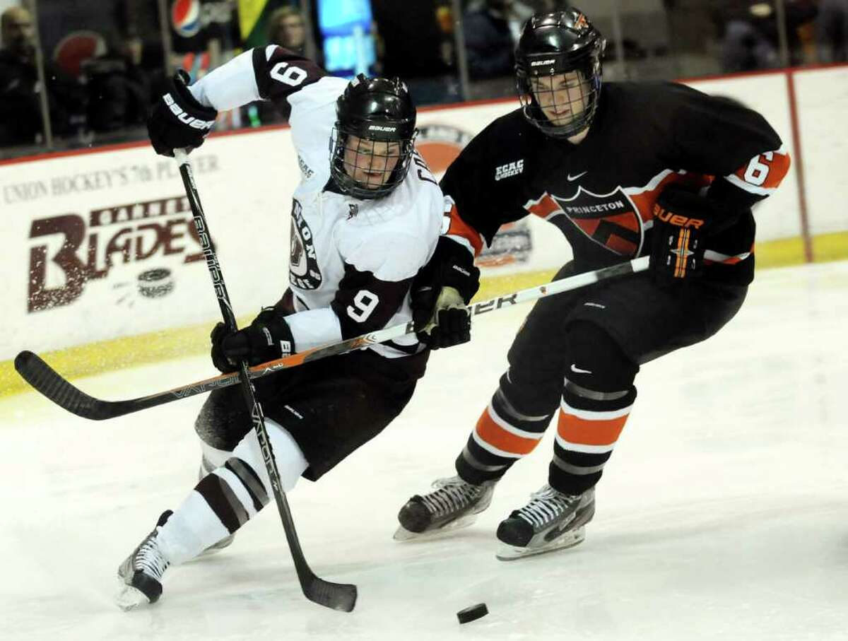 Union's Daniel Carr (9), left, moves the puck behind the net as Princeton's Jeremy Goodwin (6) defends during their hockey game on Friday, Feb. 17, 2012, at Union College in Schenectady, N.Y. (Cindy Schultz / Times Union)