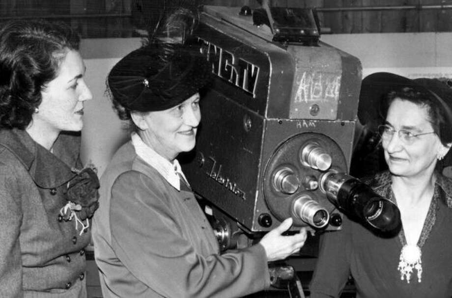 Dorothy Bullitt, the founder of King Broadcasting, shows a KING TV camera three years after the station started as KRSC-TV, more than 60 years ago.  Tegna, the company's present owner, is shutting down Northwest Cable News on January 6. (seattlepi.com file)