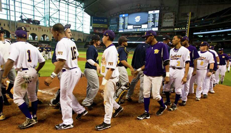 Prairie View and Southern players shake hands at the end of their game during The Urban Invitational college baseball round-robin tournament at Minute Maid Park Friday, Feb. 17, 2012, in Houston. Southern beat Prairie View 6-0. Photo: Brett Coomer, Houston Chronicle / © 2012 Houston Chronicle