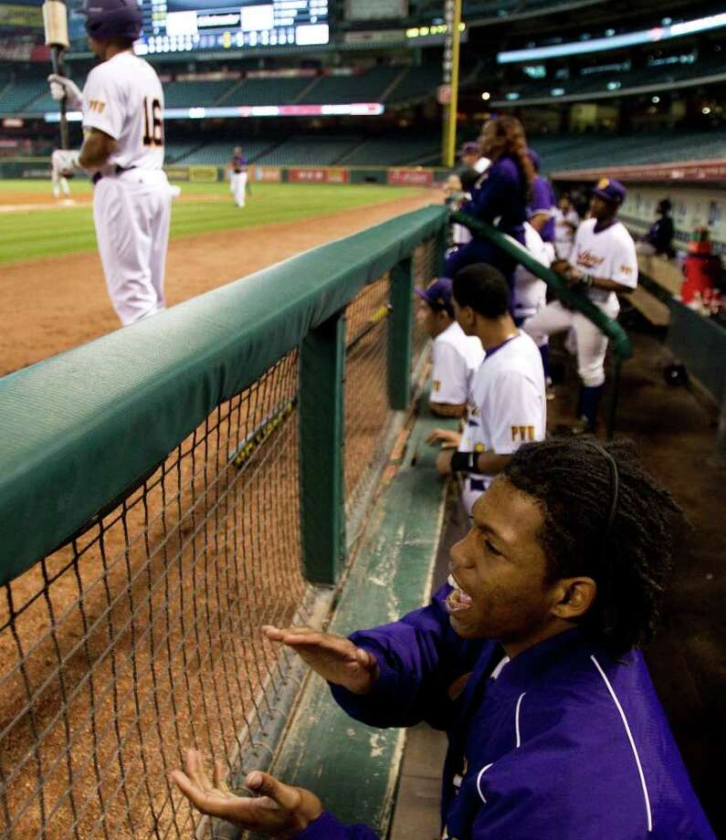 Prairie View infielder James Fontenot, lower right, cheers on his teammates against Southern University during The Urban Invitational college baseball round-robin tournament at Minute Maid Park Friday, Feb. 17, 2012, in Houston. Southern beat Prairie View 6-0. Photo: Brett Coomer, Houston Chronicle / © 2012 Houston Chronicle