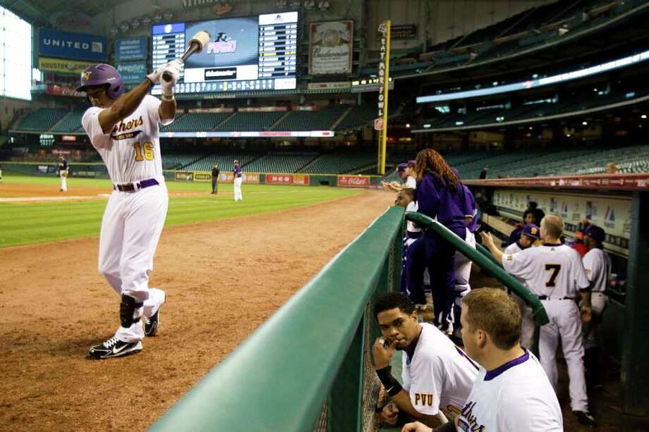 Prairie View outfielder Darryl Johnson (16) warms up on deck during The Urban Invitational college baseball round-robin tournament at Minute Maid Park Friday, Feb. 17, 2012, in Houston. Southern beat Prairie View 6-0. Photo: Brett Coomer, Houston Chronicle / © 2012 Houston Chronicle