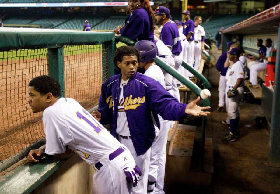 Prairie View's Andre Oliver (11) and James Fontenot, catching ball, stand in the dugout during The Urban Invitational college baseball round-robin tournament game against Southern University at Minute Maid Park Friday, Feb. 17, 2012, in Houston. Southern beat Prairie View 6-0. Photo: Brett Coomer, Houston Chronicle / © 2012 Houston Chronicle