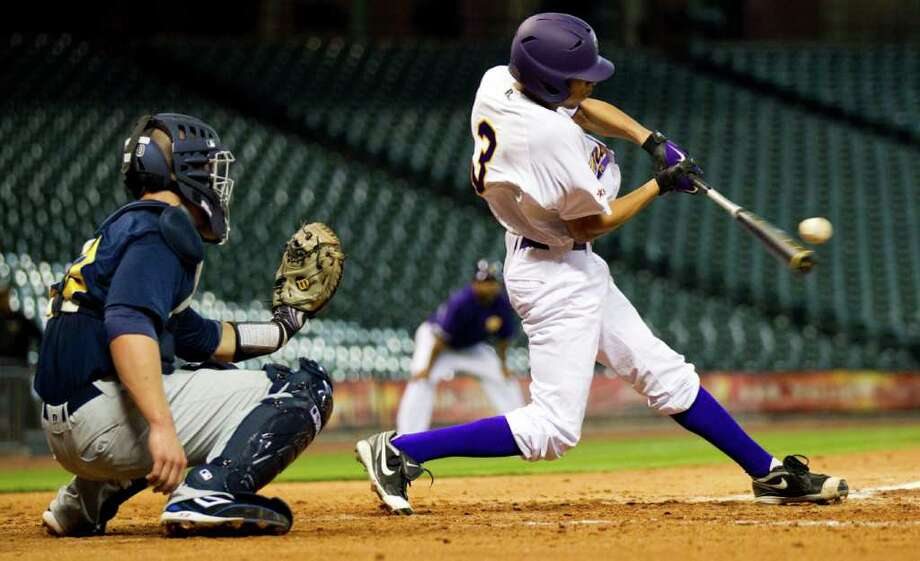 Prairie View outfielder Brandon Brooks (3) slaps a single against Southern during The Urban Invitational college baseball round-robin tournament at Minute Maid Park Friday, Feb. 17, 2012, in Houston. Southern beat Prairie View 6-0. Photo: Brett Coomer, Houston Chronicle / © 2012 Houston Chronicle