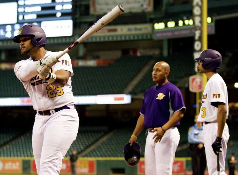 Prairie View's Dominiq Harris (25) warms up on deck as assistant coach Byron Carter, Jr., talks to outfielder Brandon Brooks (3) against Southern University during The Urban Invitational college baseball round-robin tournament at Minute Maid Park Friday, Feb. 17, 2012, in Houston. Southern beat Prairie View 6-0. Photo: Brett Coomer, Houston Chronicle / © 2012 Houston Chronicle