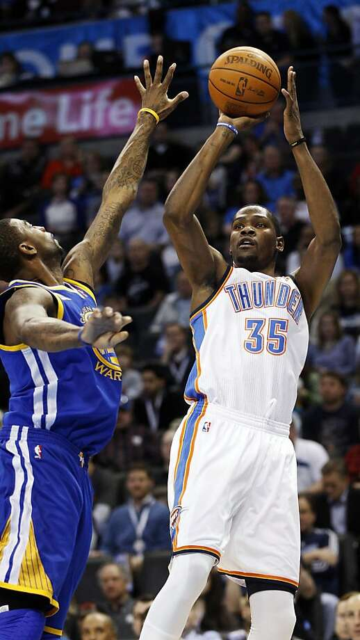 Oklahoma City Thunder forward Kevin Durant (35) shoots in front of Golden State Warriors forward Dorell Wright, left, in the first quarter of an NBA basketball game in Oklahoma City, Friday, Feb. 17, 2012. (AP Photo/Sue Ogrocki) Photo: Sue Ogrocki, Associated Press