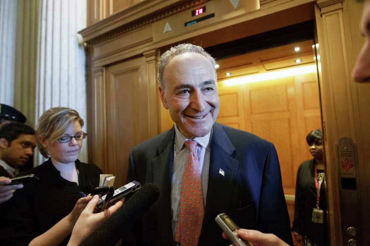 Sen. Chuck Schumer, D-N.Y., comments to reporters on Capitol Hill in Washington, Friday, Feb. 17, 2012, after the final vote in the Senate on the payroll-tax cut and jobless-benefits extension package. (AP Photo/J. Scott Applewhite)