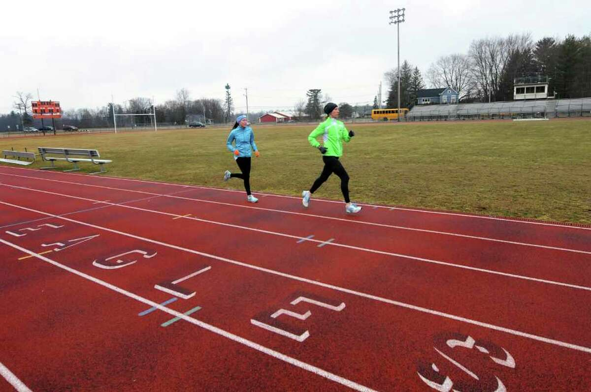 Mary DeVries, 16, left, works out with her running coach Jodie Robertson on Thursday, Feb. 14, 2012, at Bethlehem High in Bethlehem, N.Y. A group of parents are proposing improvements to the football field and running track. (Cindy Schultz / Times Union)