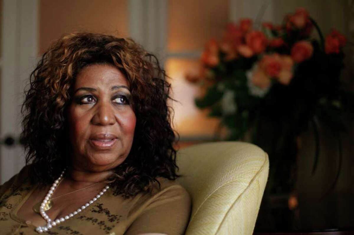 """In this July 26, 2010 photo, performer Aretha Franklin looks out a window, in Philadelphia. Franklin says she believed Whitney Houston had overcome her demons and was primed for a comeback, which made learning of the troubled singer's death all the more of a shock. Interviewed on NBC's """"Today"""" show Friday, Feb. 17, 2012, Franklin said she was watching TV in her hotel room in Charlotte, N.C., when she learned of Houston's death. (AP Photo/Matt Rourke)"""