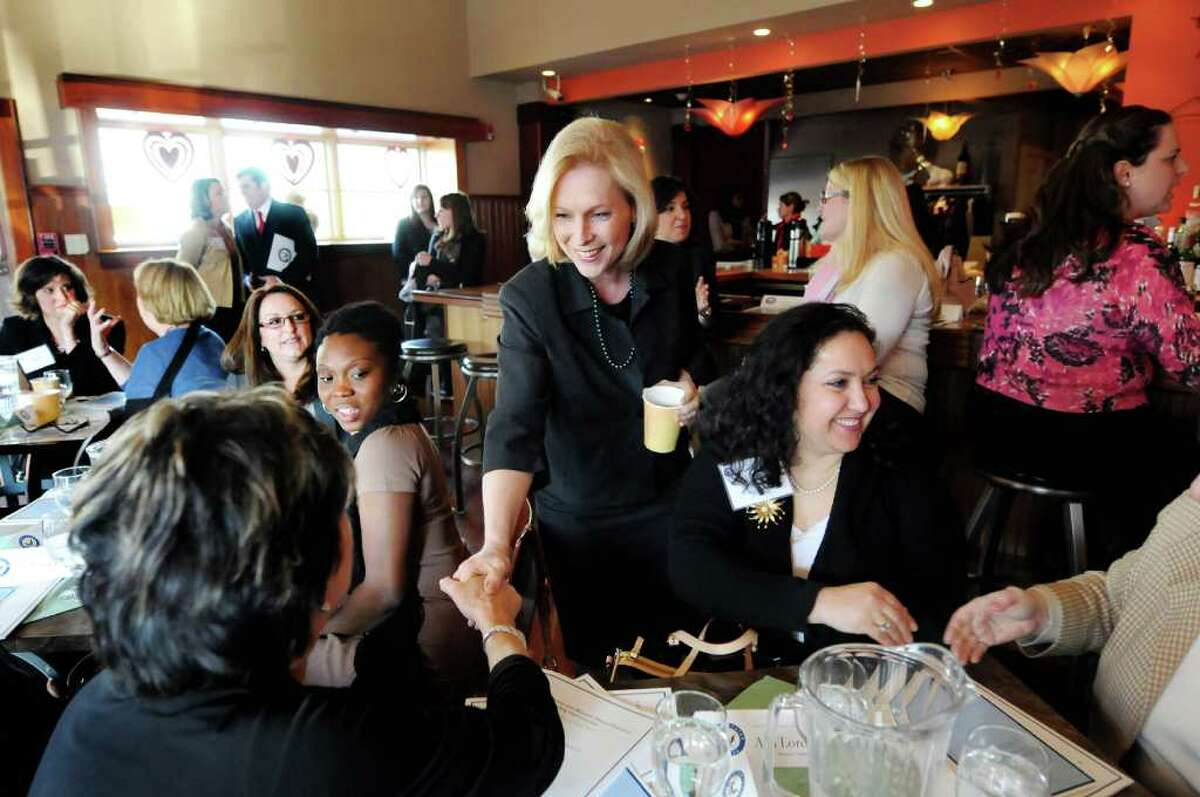 U.S. Sen. Kirsten Gillibrand, center, greets local business women during the Capital Region Women's Economic Empowerment Roundtable on Friday, Feb. 17, 2012, at the Midtown Tap & Tea Room in Albany, N.Y. (Cindy Schultz / Times Union)