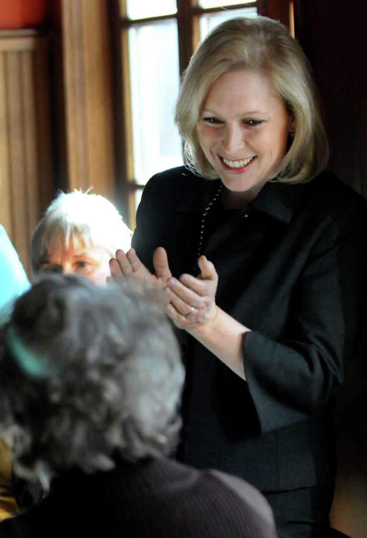 Local business women welcome U.S. Sen. Kirsten Gillibrand, right, during the Capital Region Women's Economic Empowerment Roundtable on Friday, Feb. 17, 2012, at the Midtown Tap & Tea Room in Albany, N.Y. (Cindy Schultz / Times Union)