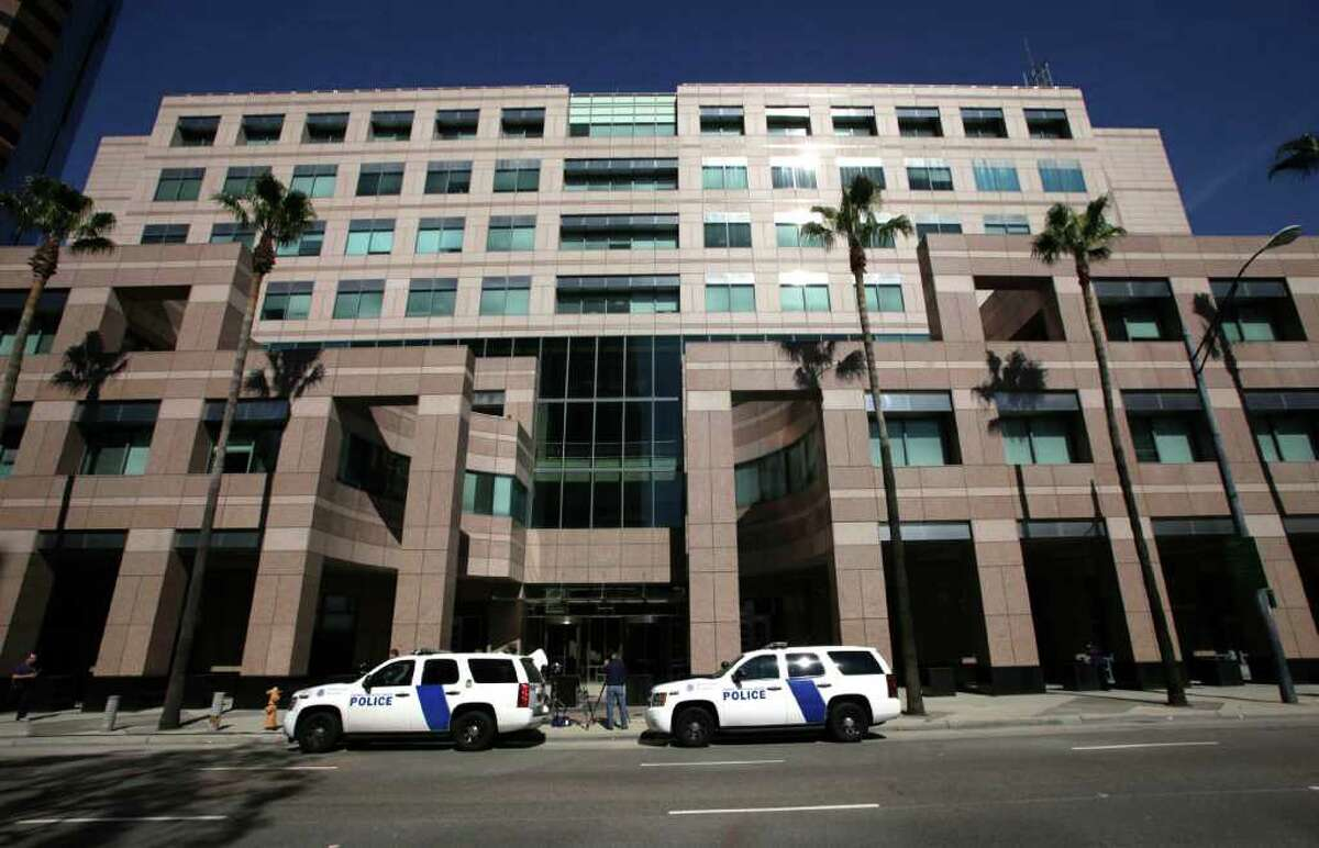Homeland Security police cars are shown parked outside the Long Beach, Calif., Federal Courthouse Friday, Feb. 17, 2012 in Long Beach, Calif. On Thursday an agent shot another agent who was then shot and killed by a third agent. The wounded agent was hospitalized. This shooting at the federal building of a high-ranking Immigration and Customs Enforcement official was over an unspecified disciplinary matter, a person familiar with the case said. (AP Photo/Nick Ut)