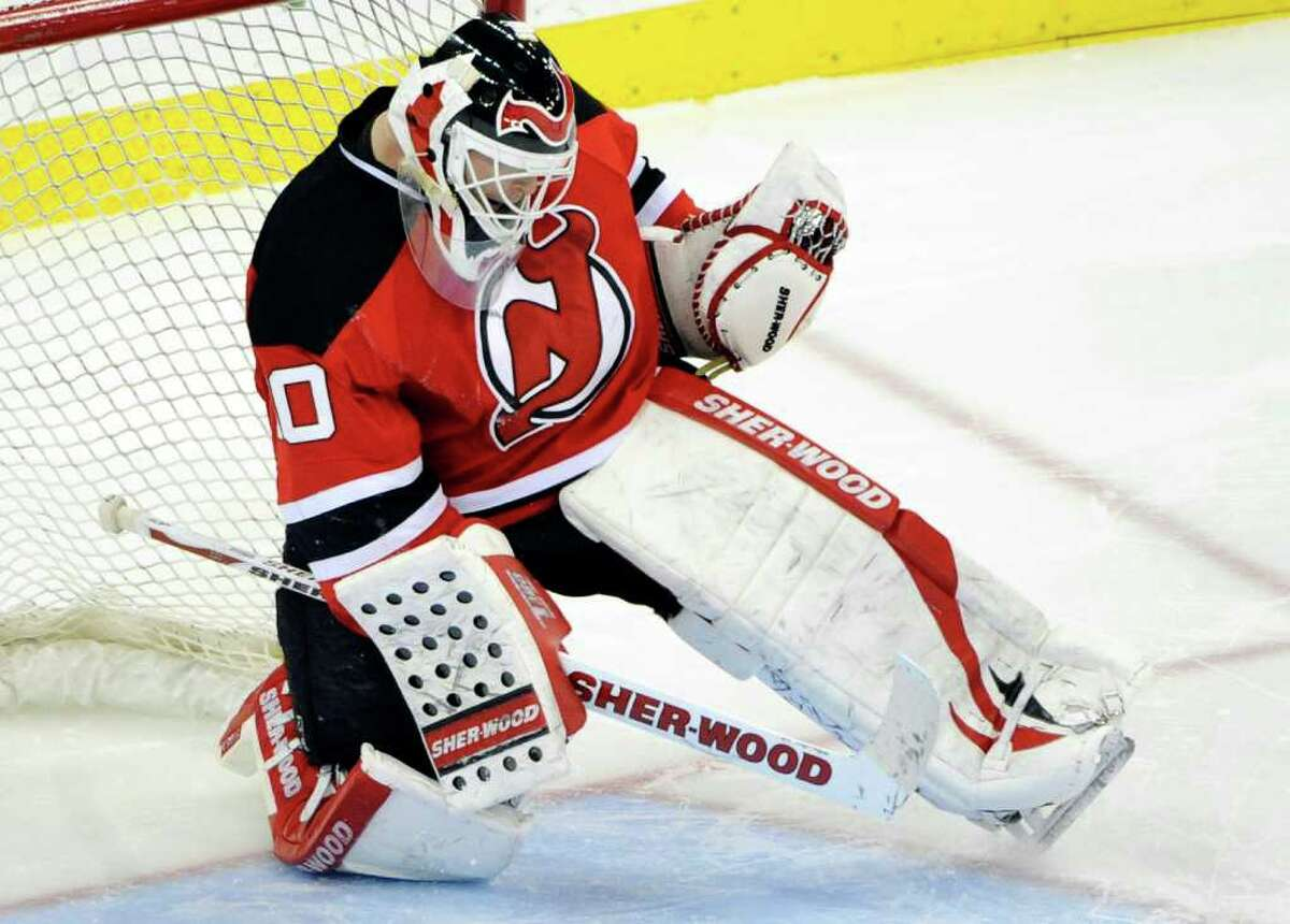 New Jersey Devils goaltender Martin Brodeur reacts after stopping a shot by Anaheim Ducks' Ryan Getzlaf to defeat the Ducks 3-2, in a shootout during an NHL hockey game Friday, Feb. 17, 2012, in Newark, N.J. (AP Photo/Bill Kostroun)