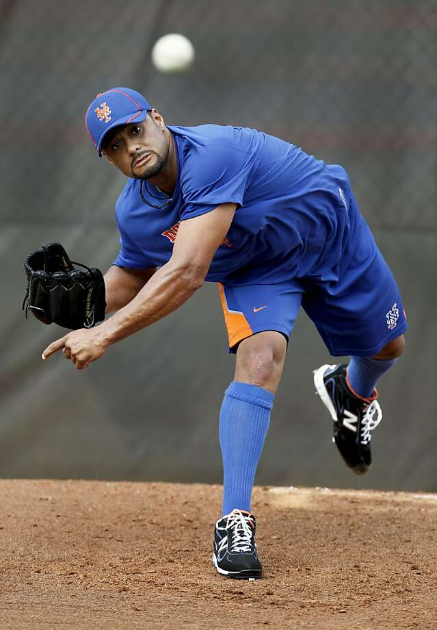 New York Mets pitcher Johan Santana throws a bullpen session during spring training baseball, Friday, Feb. 17, 2012, in Port St. Lucie, Fla. The session was first time the two-time Cy Young Award winner has thrown off a mound since pitching four innings in an instructional league game on Sept. 30. Santana had surgery on his left shoulder in September 2010 has not pitched in a major league game since then. (AP Photo/Jeff Roberson) Photo: Jeff Roberson, Associated Press