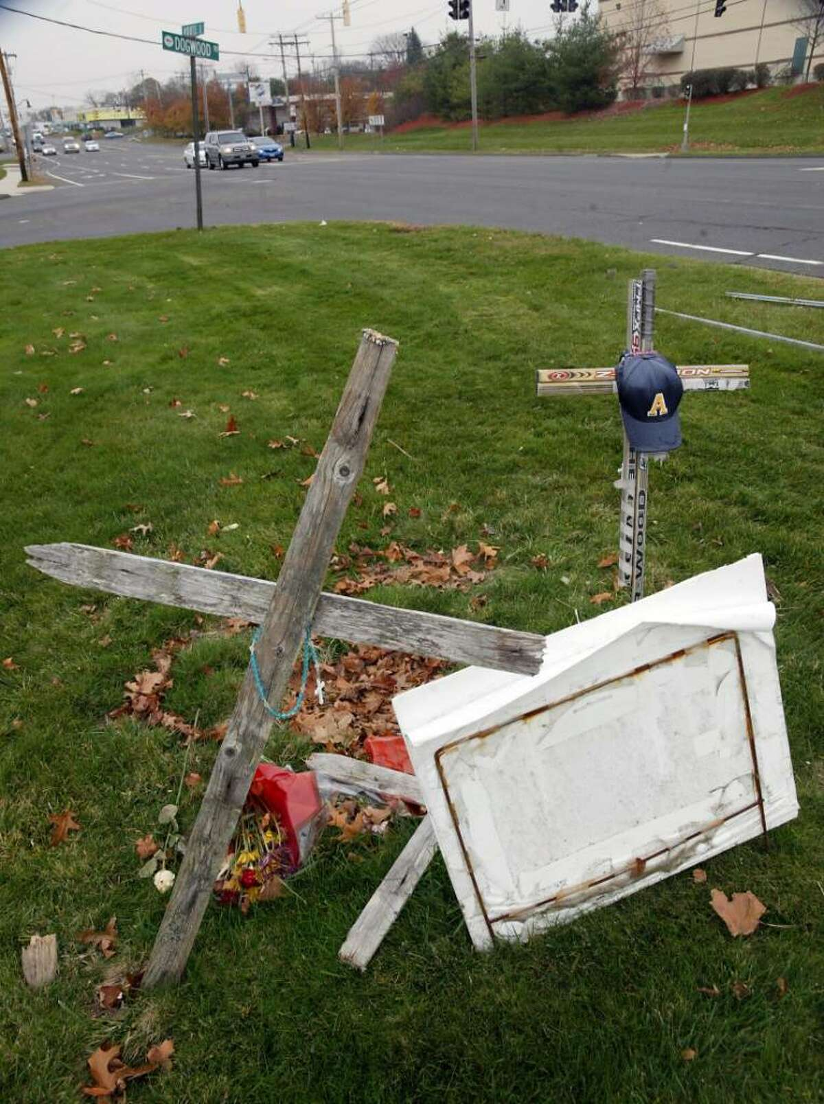 A memorial still stands near the intersection of the Post Road at Dogwood Road in Orange where teenagers Dave Servin and Ashlie Krakowski were killed in the early morning hours of June 13, 2009 when their Mazda was broadsided by Milford officer Jason Anderson's police cruiser.
