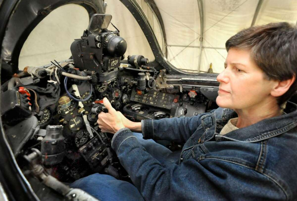 Lynn Brown, in the cockpit of a MiG-17, high-subsonic performance jet fighter, made in the USSR, in 1958, in the Hanger of her Danbury home, on Nov.2,2009.