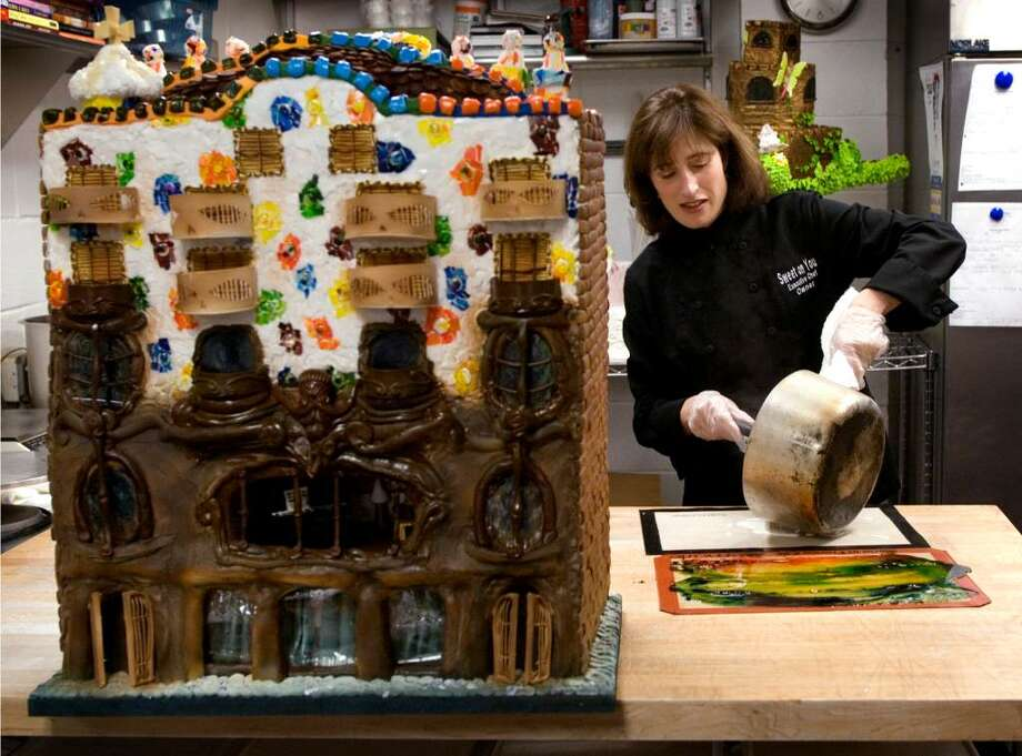 """Rebecca Martin, owner of Sweet On You Bakery and Cafe in Stamford, Conn at the JCC, is one of several local chefs who have created gingerbread houses for the Stamford Museum & Nature Center's upcoming exhibit, """"Visions of Gingerbread. She pours out sugar soulution that will harden and then she uses it to make the tile decorations on the Gaudi building she created. Photo: Dru Nadler / Stamford Advocate"""