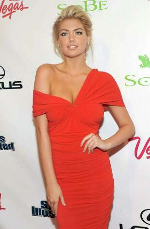 Sports Illustrated Swimsuit edition cover model Kate Upton poses at the magazine's launch party in New York, Tuesday, Feb. 14, 2012. Photo: AP