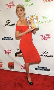 Sports Illustrated Swimsuit edition cover model Kate Upton celebrates at the magazine's launch party in New York, Tuesday, Feb. 14, 2012. Photo: AP