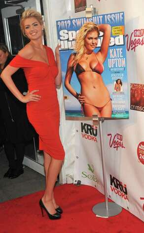 Sports Illustrated Swimsuit edition cover model Kate Upton celebrates her cover at the magazine's launch party in New York, Tuesday, Feb. 14, 2012. Photo: AP