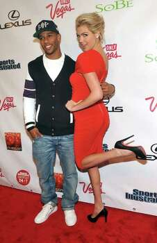 Sports Illustrated Swimsuit edition cover model Kate Upton poses with New York Giants football player Victor Cruz at the magazine's launch party in New York, Tuesday, Feb. 14, 2012. Photo: AP