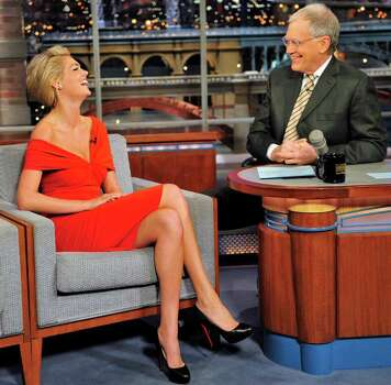 "In this photo provided by CBS, Sports Illustrated Swimsuit Issue cover model Kate Upton joins host David Letterman on the set of the ""Late Show with David Letterman,"" Tuesday, Feb. 14, 2011 in New York. (AP Photo/CBS, John Paul Filo) MANDATORY CREDIT; NO ARCHIVE; NO SALES; NORTH AMERICAN USE ONLY Photo: AP"