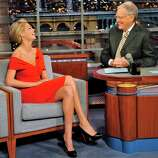 """In this photo provided by CBS, Sports Illustrated Swimsuit Issue cover model Kate Upton joins host David Letterman on the set of the """"Late Show with David Letterman,"""" Tuesday, Feb. 14, 2011 in New York. (AP Photo/CBS, John Paul Filo) MANDATORY CREDIT; NO ARCHIVE; NO SALES; NORTH AMERICAN USE ONLY"""