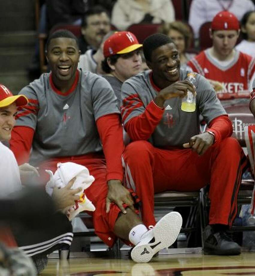 Rockets forward Terrence Williams, left, and guard Jonny Flynn sit on the bench together during the first half. (Karen Warren / Houston Chronicle)