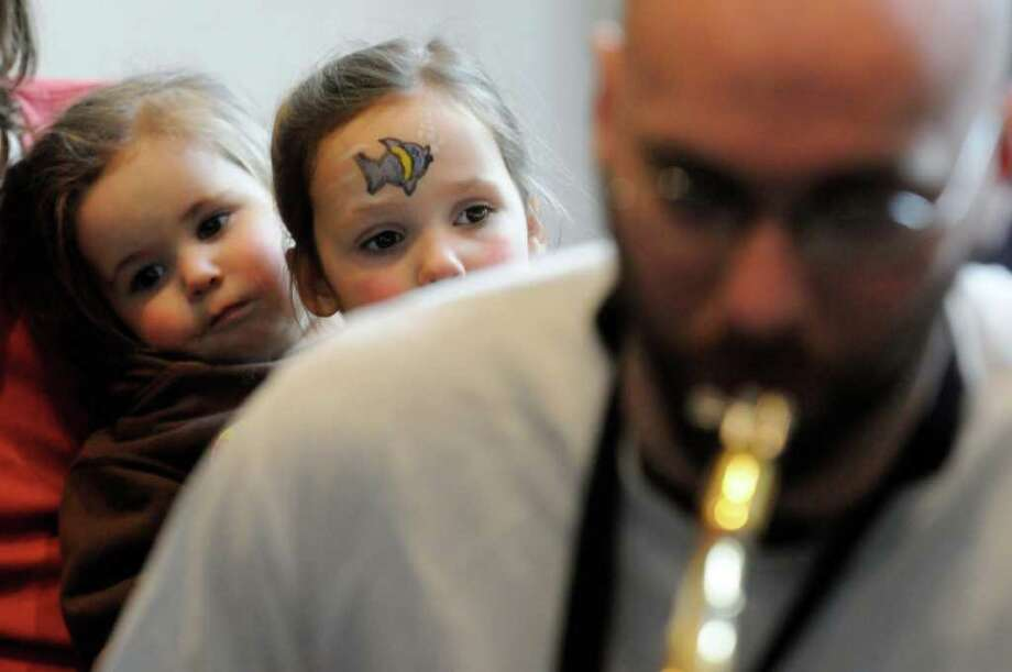 One-year-old Estrella,left, and her three-year-old sister Morriah Shemdyker of Greenfield listen to a musicians jam session as part of Dance Flurry 2012 in Saratoga Springs , N.Y. Saturday Feb.18, 2012. ( Michael P. Farrell/Times Union) Photo: Michael P. Farrell