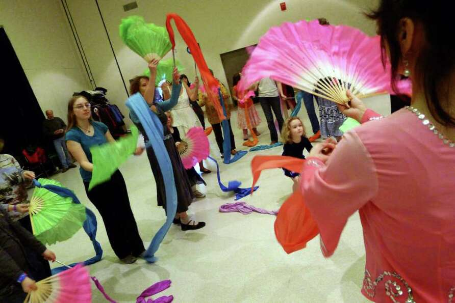 Xin Hua Lee ,lright, leads a class in Chinese Ribbon and Fan Dancing as part of Dance Flurry 2012 in