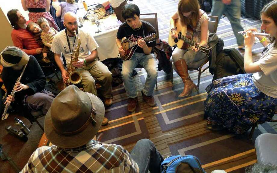 Musicians hold an impromptu jam sessession as part of Dance Flurry 2012 in Saratoga Springs , N.Y. Saturday Feb.18, 2012. ( Michael P. Farrell/Times Union) Photo: Michael P. Farrell / 00016471A