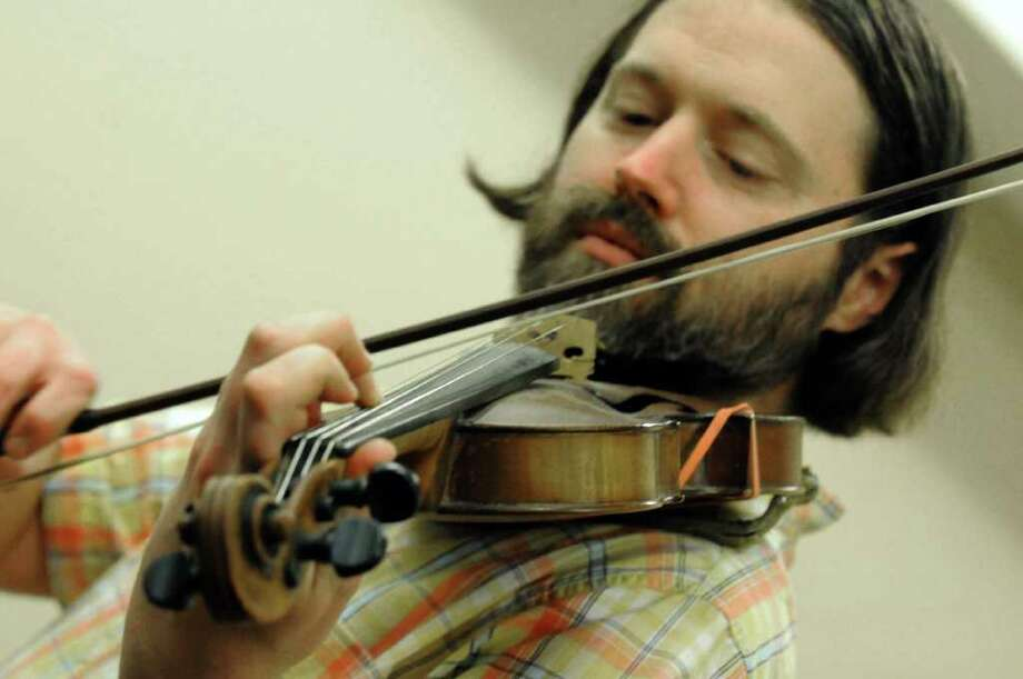 Eric Buddington teaches a workshop on the Basics of Fiddle Technique as part of Dance Flurry 2012 in Saratoga Springs , N.Y. Saturday Feb.18, 2012. ( Michael P. Farrell/Times Union) Photo: Michael P. Farrell