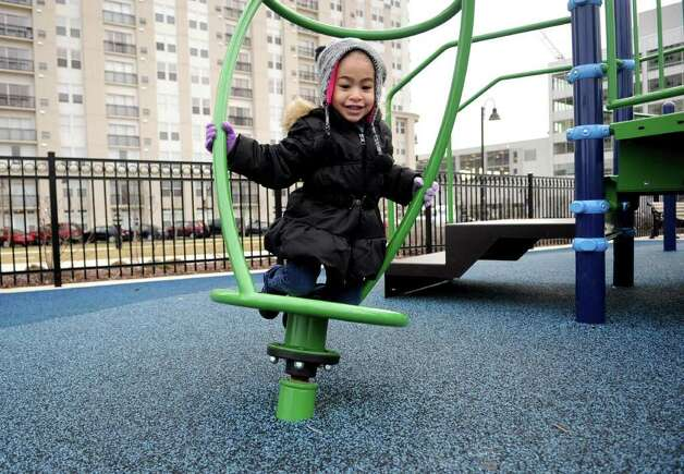 Zoe Bates, 3, plays at Commons Park in Harbor Point in Stamford on Saturday, February 18, 2012. Photo: Lindsay Niegelberg / Stamford Advocate