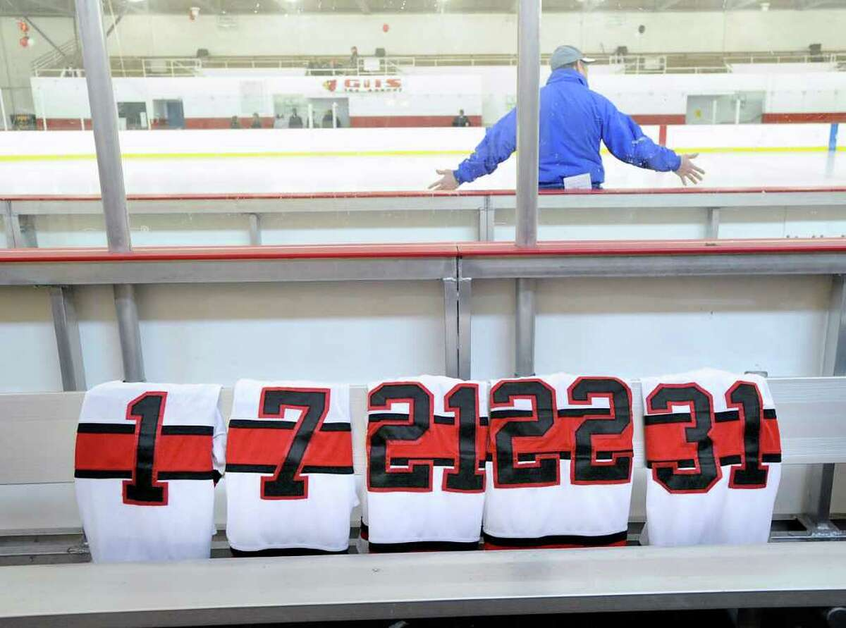 The jerseys of the GHS seniors lined-up on the bench prior to boys high school ice hockey game between Fairfield co-op and Greenwich High School at Hamill Rink in Byram Saturday, Feb. 18, 2012.