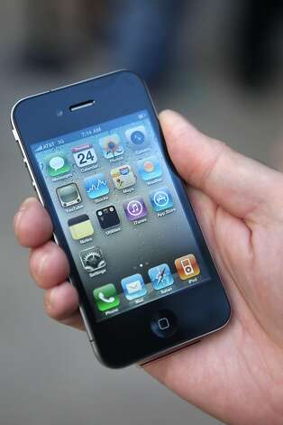 Sales of the popular iPhone have helped Apple's market value surge. Photo: Kiichiro Sato, AP