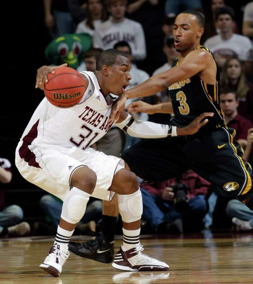 Missouri's Matt Pressey (3) tries to steal the ball from Texas A&M's Elston Turner (31) during the first half of an NCAA college basketball game, Saturday, Feb. 18, 2012, in College Station, Texas. (AP Photo/David J. Phillip) Photo: David J. Phillip / AP