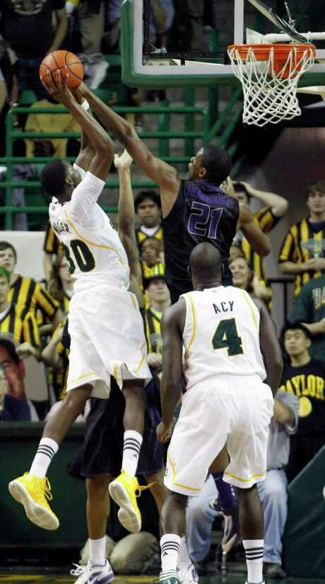 Baylor's Quincy Miller (left) takes the last shot of the game, only to be blocked by Kansas State's Jordan Henriquez. Photo: AP