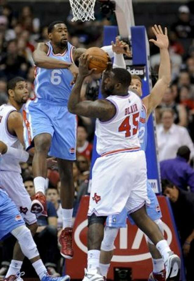 Los Angeles Clippers center DeAndre Jordan (6) blocks a shot by San Antonio Spurs forward DeJuan Blair (45) in the first half of an NBA basketball game Saturday, Feb. 18, 2012, in Los Angeles. (AP Photo/Gus Ruelas) (AP)