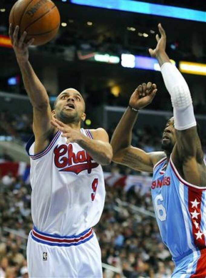 San Antonio Spurs guard Tony Parker (9), of France, gets by Los Angeles Clippers center DeAndre Jordan (6) for a basket during the second half of an NBA basketball game, Saturday, Feb. 18, 2012, in Los Angeles. The Spurs won 103-100. (AP Photo/Gus Ruelas) (ASSOCIATED PRESS)