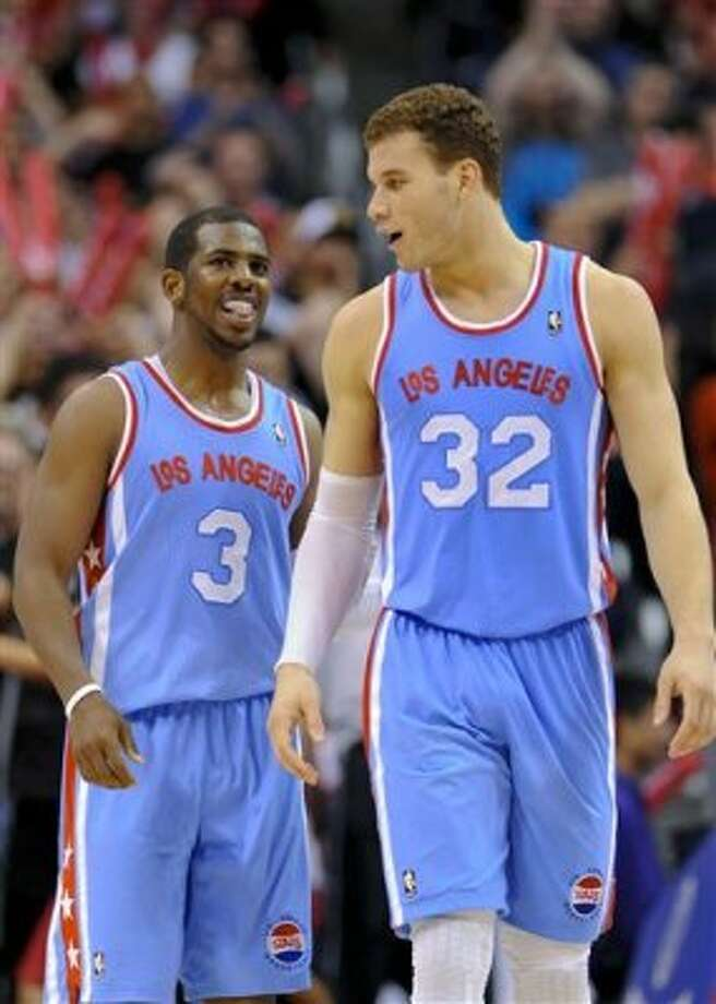 Los Angeles Clippers guard Chris Paul (3) and forward Blake Griffin (32) celebrate a brief lead in the second half of an NBA basketball game against the San Antonio Spurs, Saturday, Feb. 18, 2012, in Los Angeles. The Spurs won 103-100 in overtime. (AP Photo/Gus Ruelas) (AP)