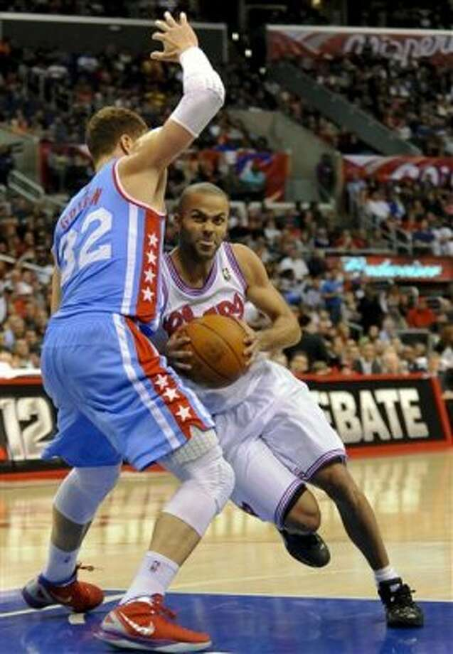 San Antonio Spurs guard Tony Parker (9), of France, drives against Los Angeles Clippers forward Blake Griffin (32) in the second half of an NBA basketball game, Saturday, Feb. 18, 2012, in Los Angeles. The Spurs won 103-100. (AP Photo/Gus Ruelas) (ASSOCIATED PRESS)