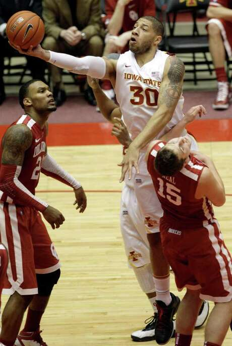 Iowa State forward Royce White, who had just four points Saturday, drives on Oklahoma's Romero Osby (left) and Tyler Neal. Photo: AP