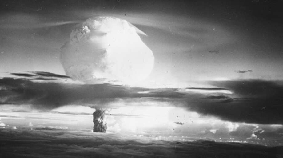Circa 1952: The mushroom cloud of fire and smoke rises 40,000 feet in two minutes after the Hydrogen Bomb explosion at Eniwetok Atoll in the Pacific. (Photo by Three Lions/Getty Images)
