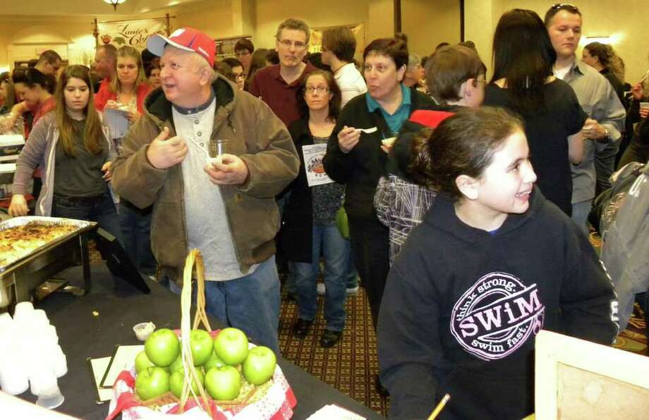 Macaroni and cheese lovers taste samples from 29 Capital Region restaurants during the Mac-n-Cheese Bowl on Saturday. (Steve Barnes / Times Union)