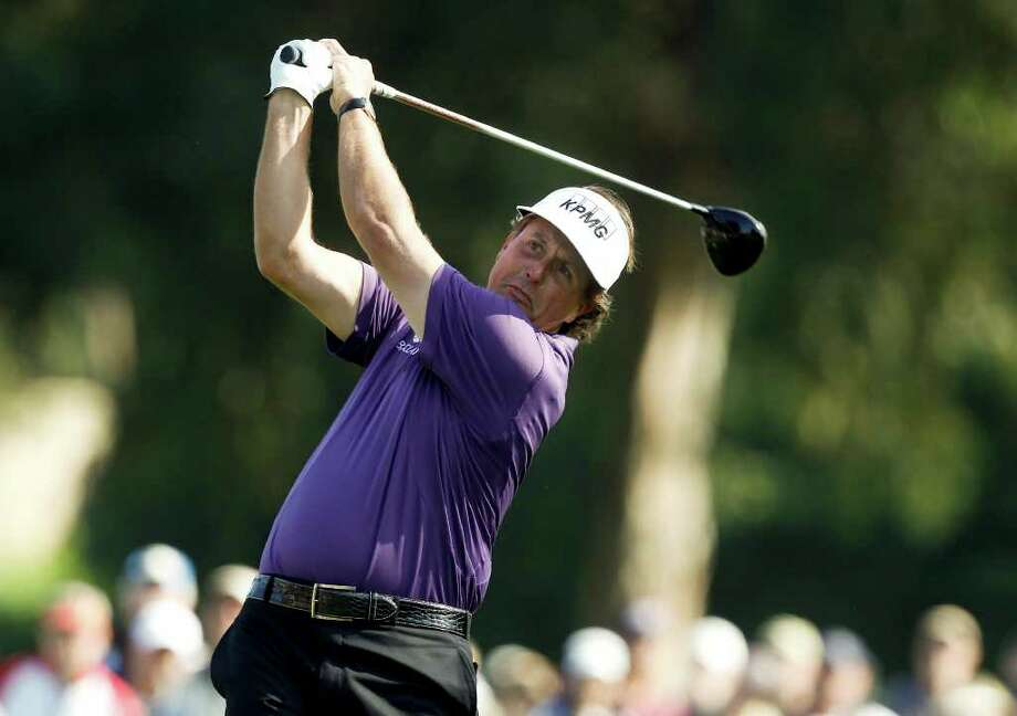 Phil Mickelson watches his tee shot on the second hole during the third round of the Northern Trust Open. Photo: AP