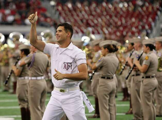 A Texas A&M Aggies yell leader gets the crowd going before the game against the Arkansas Razorbacks at the Southwest Classic football game at Cowboys Stadium in Irving, Texas on Saturday, Oct. 9, 2010. Kin Man Hui/kmhui@express-news.net Photo: KIN MAN HUI, SAN ANTONIO EXPRESS-NEWS / San Antonio Express-News