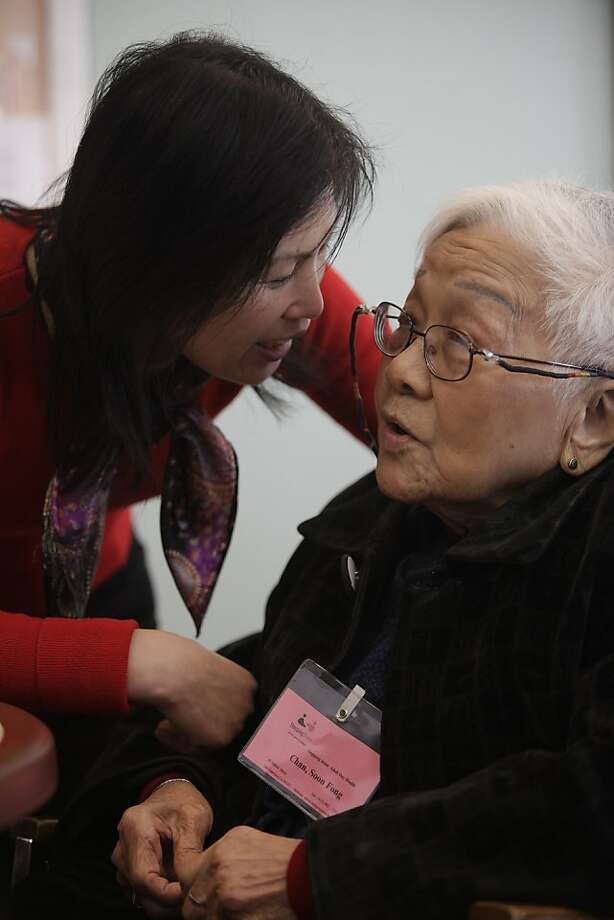 Mei Chen (l to r), activity coordinator, talks with Chan Soon Fong, 92, in the Day Room at the SteppingStone Mabini Day Health on Tuesday, February 14, 2012 in San Francisco, Calif. Photo: Lea Suzuki, The Chronicle