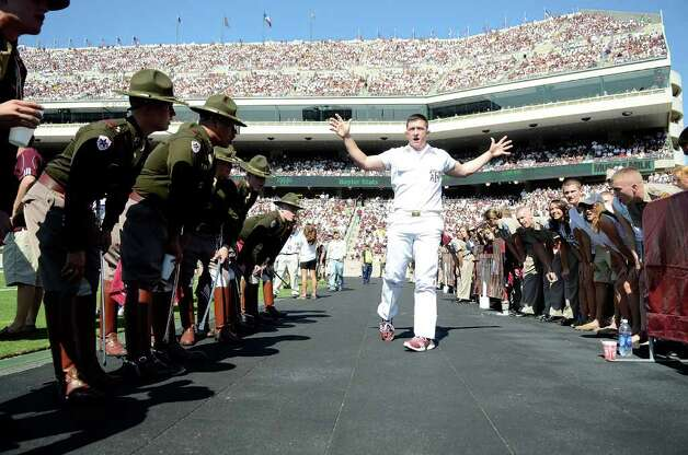 COLLEGE STATION, TX - OCTOBER 15: A Texas A&M Yell Leader cheers during a game against the Baylor Bears at Kyle Field on October 15, 2011 in College Station, Texas. The Texas A&M Aggies defeated the Baylor Bears 55-28. Photo: Sarah Glenn, Getty Images / 2011 Getty Images