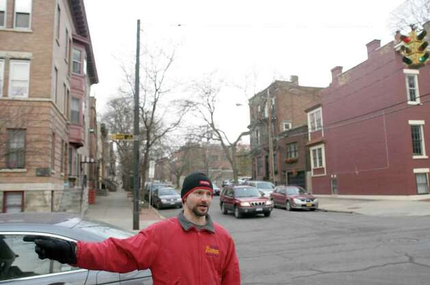 George de Piro of Albany stands near the intersection of Dove St. and Chestnut St. during an interview on Thursday, Feb. 16, 2012 in Albany, NY where he talked about areas that are dangerous for pedestrians.  (Paul Buckowski / Times Union) Photo: Paul Buckowski