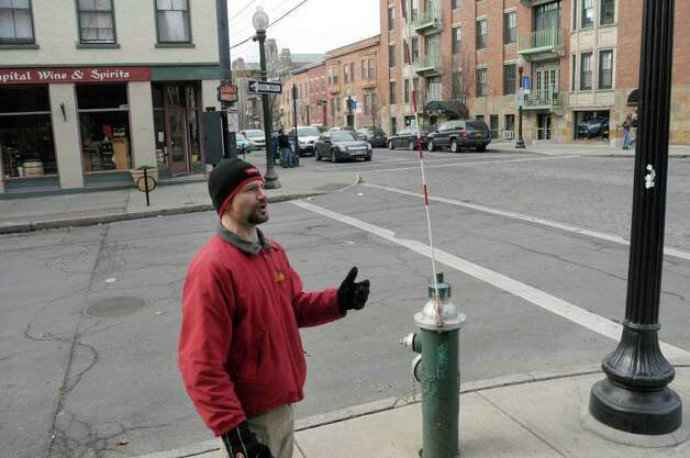 George de Piro of Albany stands near the intersection of State St. and Lark St. during an interview on Thursday, Feb. 16, 2012 in Albany, NY where he talked about areas that are dangerous for pedestrians.  (Paul Buckowski / Times Union) Photo: Paul Buckowski
